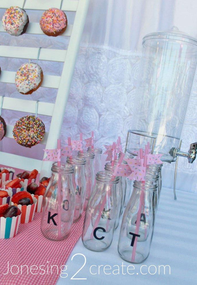 Monogramed milk bottles on donut food table
