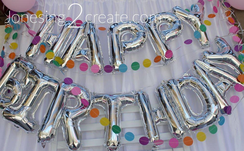 Silver balloon happy birthday banner
